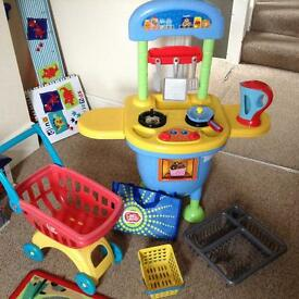 TOY KITCHEN, SHOPPING TROLLEY, BASKET, BAG AND LOADS OF ACCESSORIES