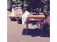 Antique Vintage Foldaway Singer Sewing Machine inside a Table