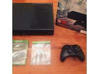 Xbox one 1TB 4 months old. Barely used. (comes with games)