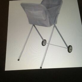 White laundry wheeled trolley, excellent way to take to washing line in garden.