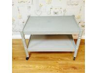 Wooden coffee table in shabby chic style