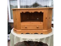 A pine corner TV unit with drawer in good condition