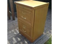 A nice 2 drawer wooden filing cabinet suitable for any working environment.