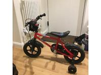 """Red 12"""" bike with stabilisers. Good condition rrp £60"""
