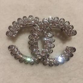 Chanel brooch as seen on Chanel