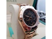 Black faced Rolex Daytona with black face rosegold casing & all rosegold bracelet comes in Rolex box