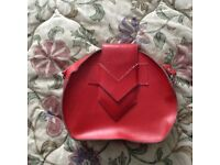 A Retro Red Almost Round Ladies Handbag with Strap