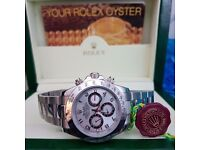 New Boxed silver dial silver bracelet and casing Rolex daytona Comes Rolex Bagged and Boxed