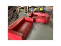 Red leatherette sofas