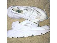 Triple white huarache trainers