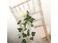 Wedding decor from Lily Special Events includes chair decoration, centrepieces, floral arrangements