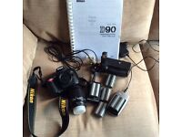 Nikon d90 with 5 batteries battery grip large info book + a lens £250 all in
