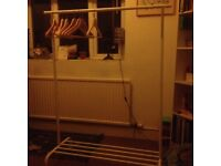 Adjustable clothes rail with shoe rack at the bottom.