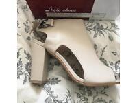 BNWT nude heeled peep toe sandals