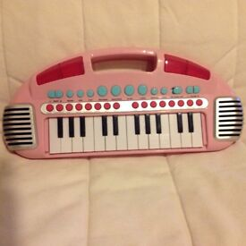 Child's small toy piano, fitted with new batteries. Also has many tunes of different types.