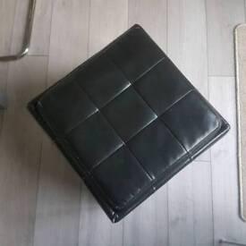 Black pouffe with storage