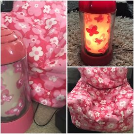 Children's pink beanbag chair and bedroom lamp
