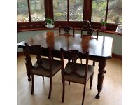 Antique extent able dining table with 4 chairs