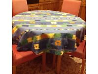 Multicoloured ( doesn't show spillage) circular cotton tablecloth