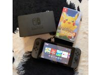 Nintendo Switch Games Console (Black) Including Game Pokemon Let's Go Pikachu
