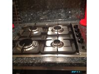 Four ring gas hob and electric cooker hood
