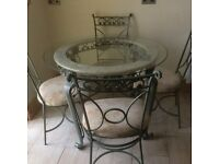 beautiful table and four chairs with toughened glass Reduced for quick clearance