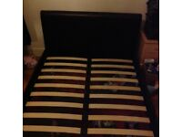 Brown leather faux double bed
