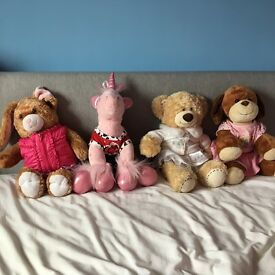 4 build-a-bears for sale. £7 each or all four for £25. Come with clothes and in amazing condition.