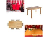 Extending dining table and 6 red chairs
