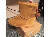 Ladies size 7 camel colour fir lined boots wth bows on back