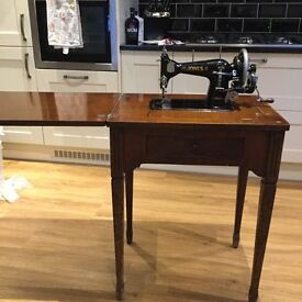 Vintage Jones sewing machine in Cabinet/table