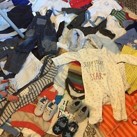 Job lot of baby boy clothes. Mixed sizes from newborn to 1year.