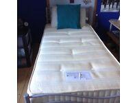 Single tubular bed with mattress