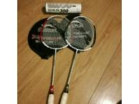 Two slazenger badminton racquets with covers and shuttlecocks