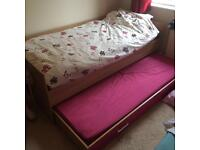 Pink trundle pull out guest single bed