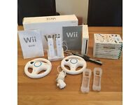 Nintendo Wii console, various controllers & 9 games