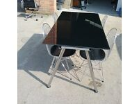 Black glass table and 4 chrome chairs
