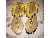 Beautiful yellow sandals with diamanté shells