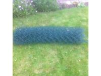 We have a roll of green wire garden mesh fencing