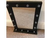 Black dressing marquee mirror Hollywood style