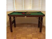 Junior snooker table with pool and snooker balls and two cues
