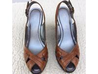 Collection of petite size3 ladies shoes and boots.