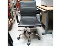 Charles Eames style operator chair with faux leather armrests