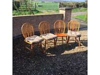 Four farmhouse wooden dining chairs