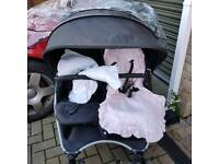 Red kite double buggy with raincovers