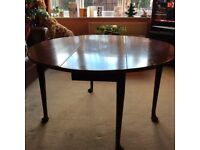 dark wood dining table gate legs seats 4 to 6