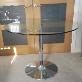 Round glass dining table seats 4