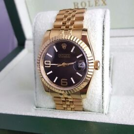 Gold Rolex DateJust with Black Face Comes Rolex Bagged and Boxed with Paperwork