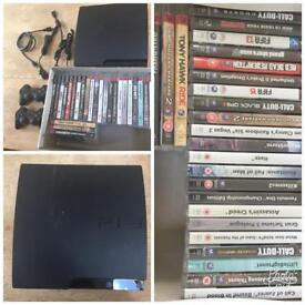 PlayStation 3 plus 2 wireless controllers & 25 top title games