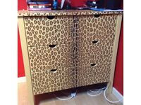 Childrens bedroom chest of drawers. IKEA units decorated in fine zebra and leopard detailing.